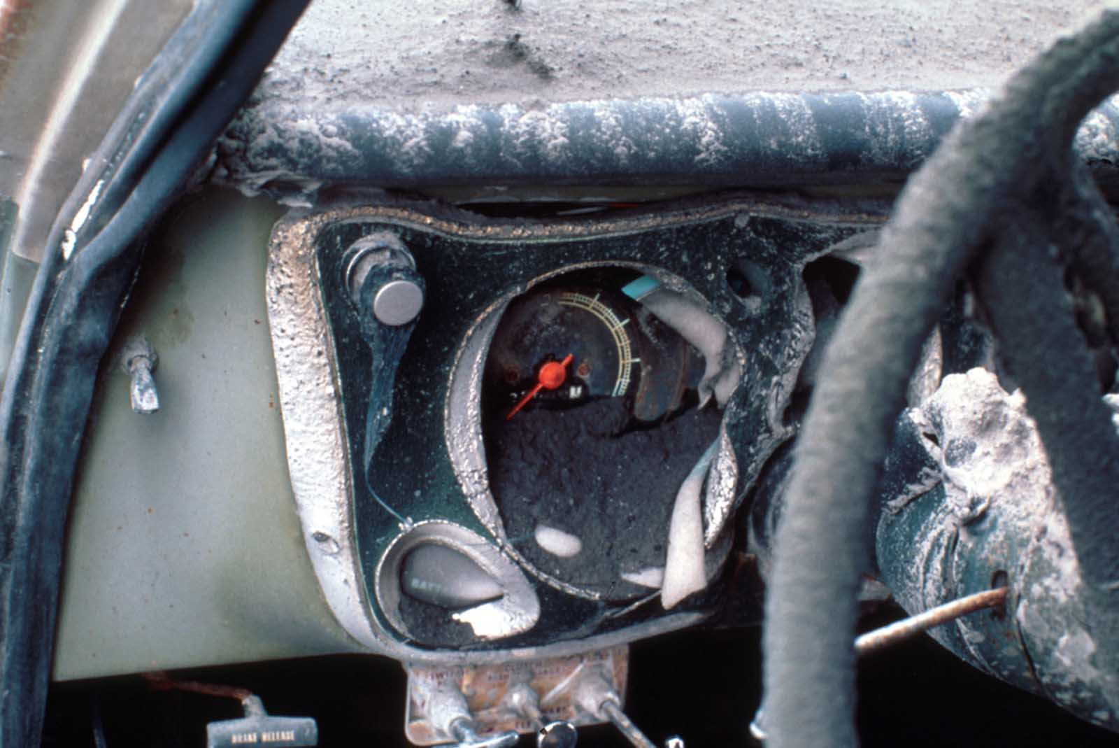 The melted dashboard of pickup truck located on ridge top about 14 km north of Mount St. Helens, in Skamania County, Washington, on June 18, 1980.