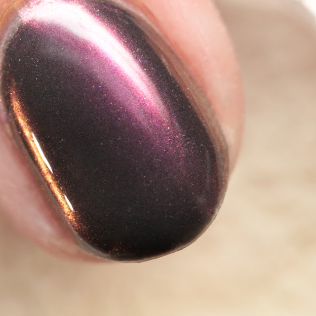 Girly Bits SFX Duo-Chrome Powder Zephyr over black gel