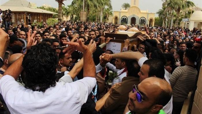 تفاصيل نقل شهداء كنيسة حلوان من المقابر حتى كنيستهم (صور)