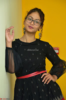Aditi Myakal in Spicy Red Short Skirt and Transparent Black Top at at Big FM For Promotion of Movie Ami Tumi 030.JPG