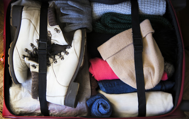 Suitcase bursting with winter clothes for the Icelandic weather