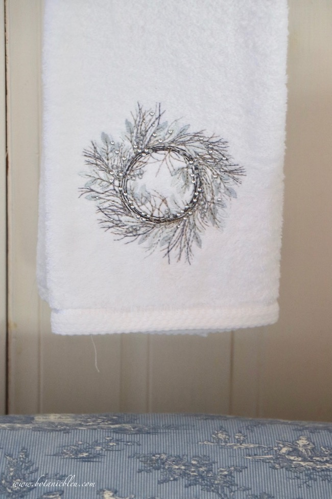 Winter blue and white bathroom wreath on hand towel