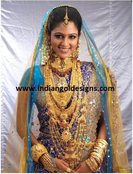 Model In Gorgeous Heavy Heavy Gold Bridal Jewellery