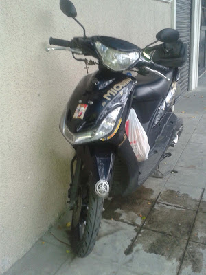Yamaha Mio Sporty Specifications Image parked sidewalk front