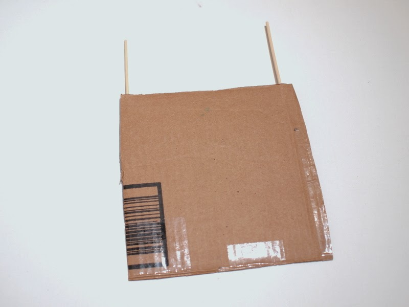 pierce skewers through the cardboard
