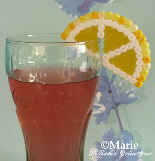 Decorating a drinks glass this summer with a simple Perler Hama fused beads fruit slice pattern