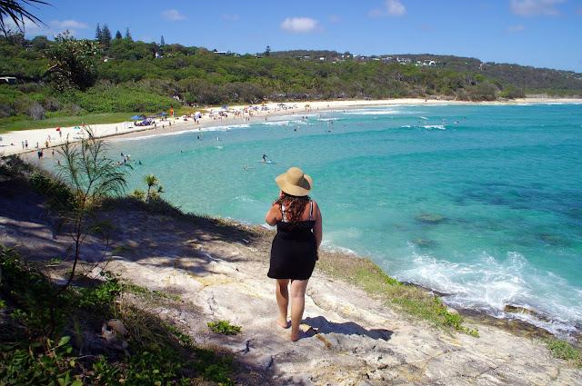 Girl overlooking Cylinder Beach Stradbroke Island