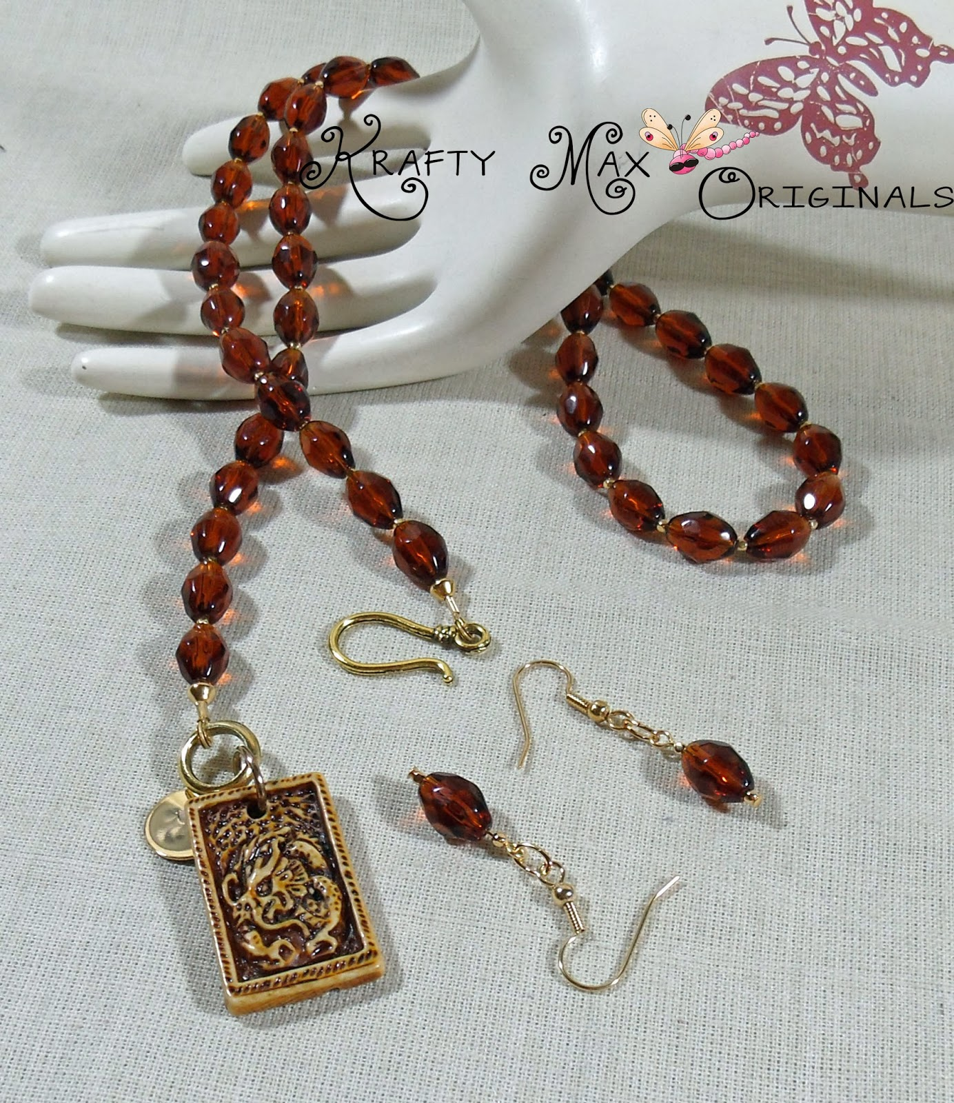 http://www.lajuliet.com/index.php/2013-01-04-15-21-51/ad/sets,85/exclusive-brown-ceramic-dragon-and-glass-beads-necklace-set-a-krafty-max-original-design,121