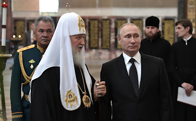 Vladimir Putin with Patriarch Kirill of Moscow and All Russia.