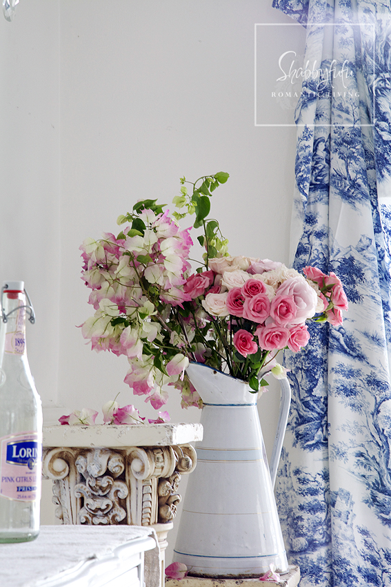 Decorating with toile - toile curtains contrast with a bright pink floral bouquet