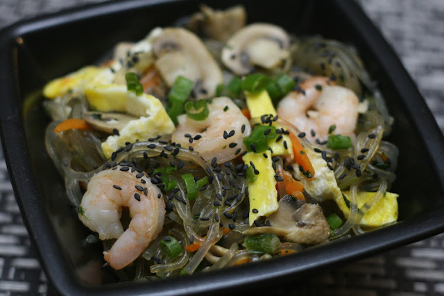 The Finished Japchae topped with shrimp, eggs, green onions, carrots