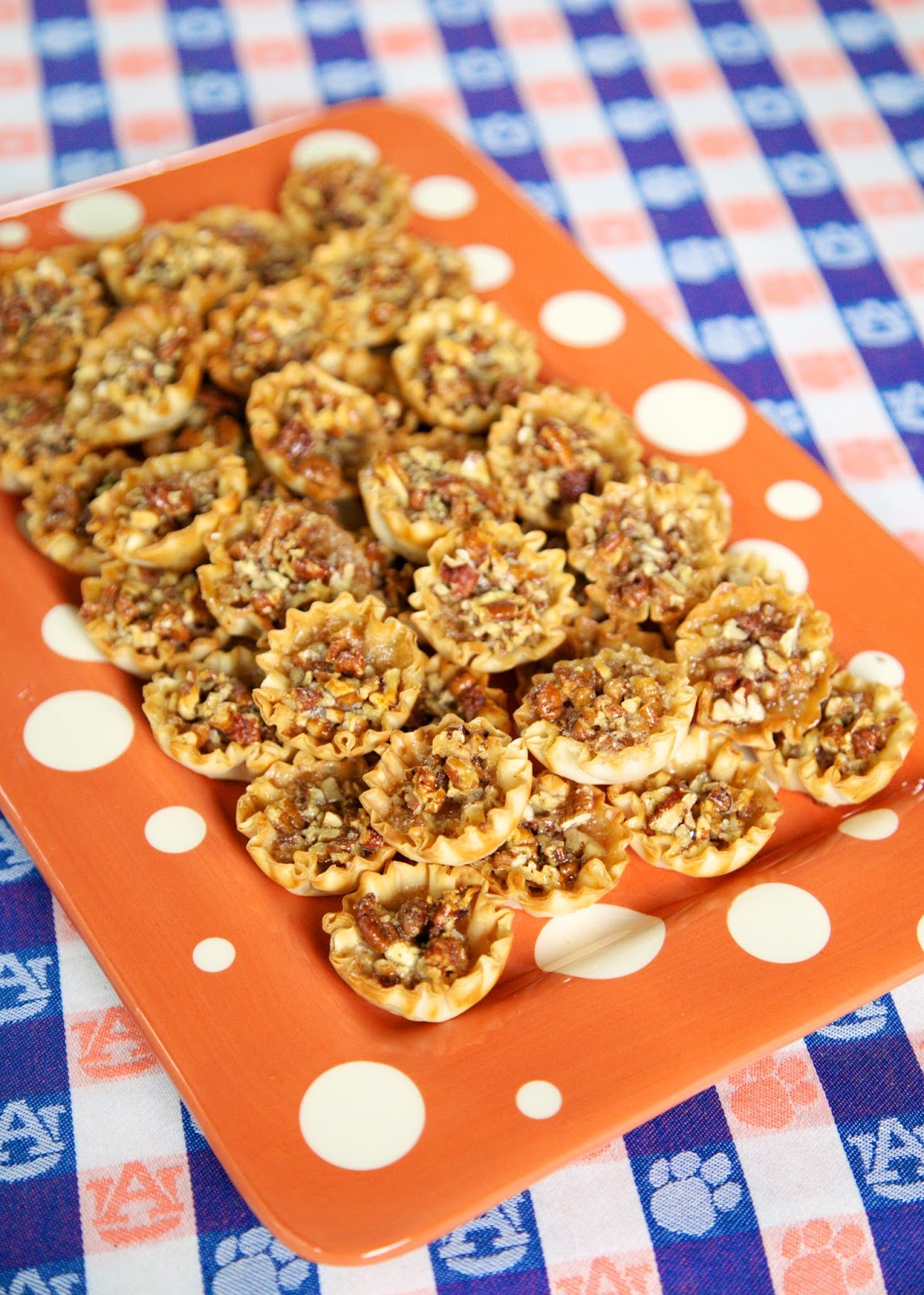 Pecan Pie Bites - pecan pie filling baked in a phyllo shell - great for parties, tailgating or Thanksgiving! Everyone LOVES these bite-sized pecan pie bites! Can make ahead of time and store in an airtight container for several days. Such a great easy dessert recipe!