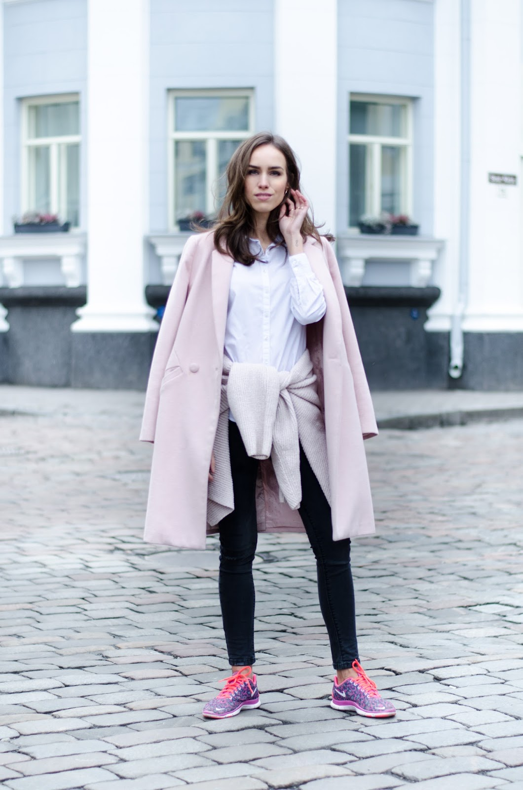 pink coat black jeans sneakers winter fashion