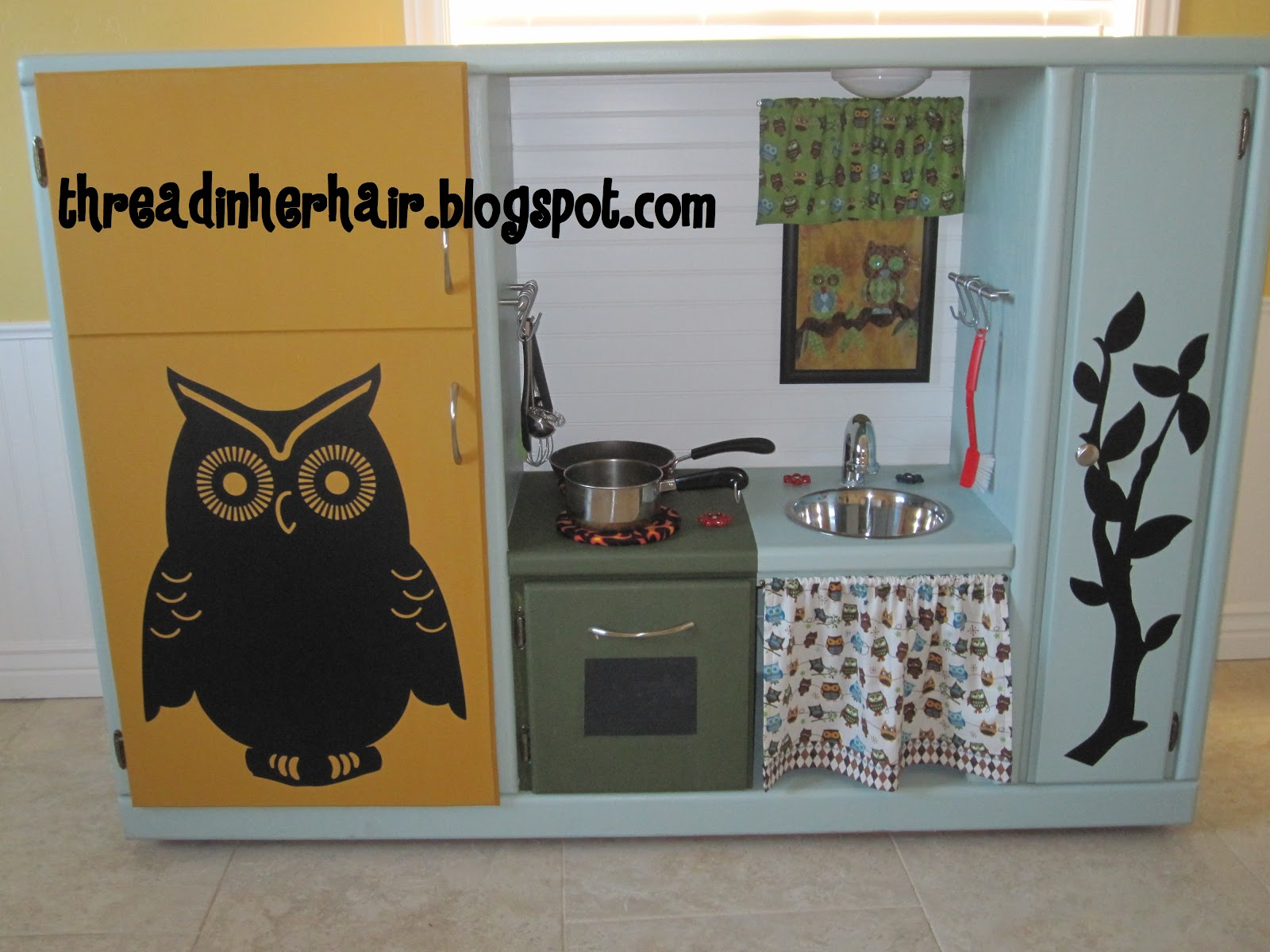 Upcycled Kitchen Entertainment Center to Play