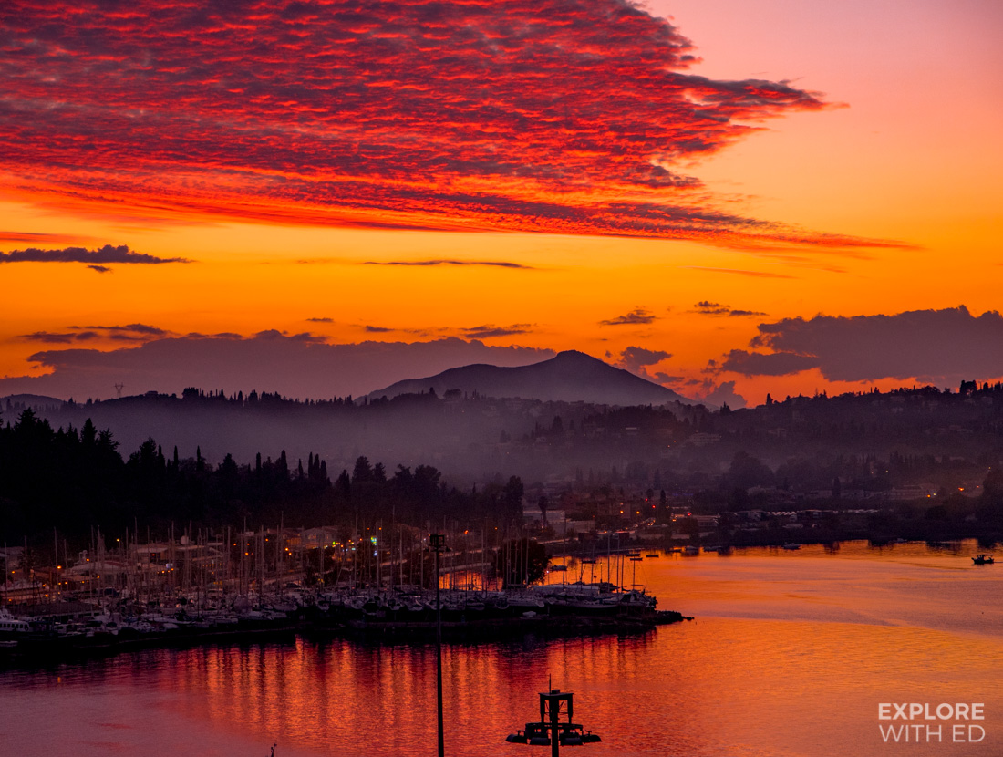 A vibrant red sunset in Corfu viewed from a cruise ship sailing the Greek Islands