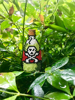Click on the image of the Bottle of Poison Beadwork by Stephanie to view larger.