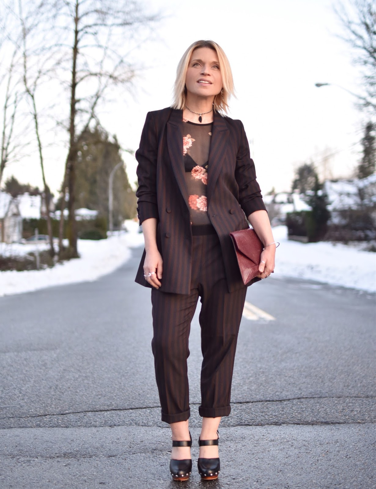Monika Faulkner outfit inspiration - styling a slouchy striped suit with a sheer top and platform mary-jane shoes