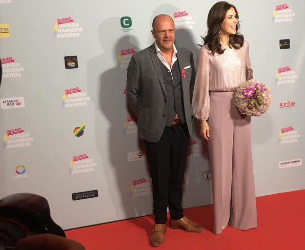Crown Princess Mary wore a baby pink high waist wide leg trousers. Diane von Furstenberg pink sequin top, Bottega Veneta