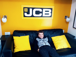 Dan Jon Jr on the Sofa Bed in the JCB Construction Cabins at Gulliver's Land