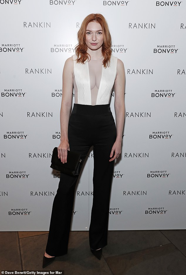 Eleanor Tomlinson Flaunts busty boobs in a plunging sheer top as she leads the stars at Rankin exhibition