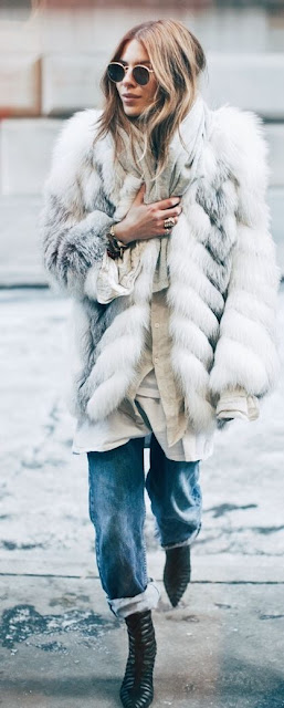 faux fur coat paired with cuffed jeans