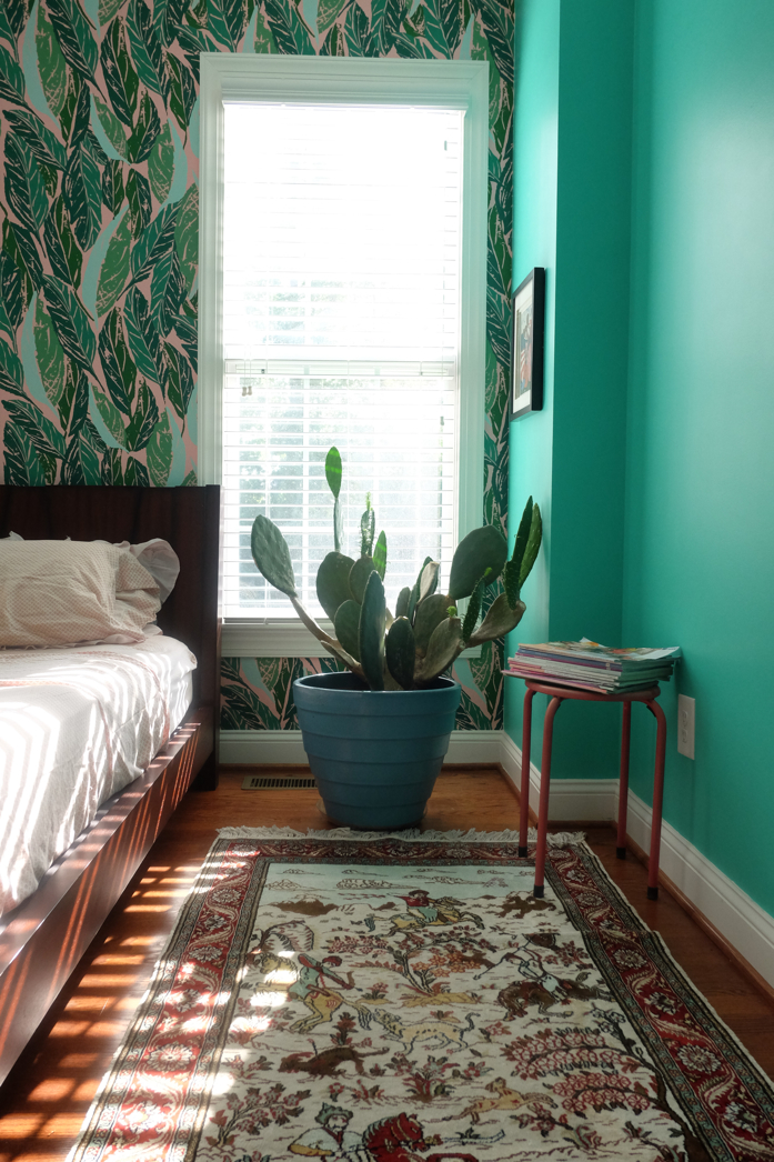 Colorful bedroom  of design addict mom with Justina Blakeney's Nana wallpaper.