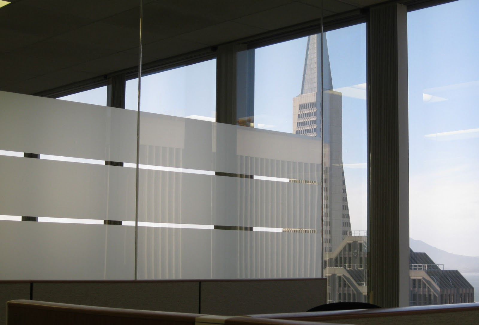 This Office With Frosted Window Film Has A View Of The Transamerica Building In Sf
