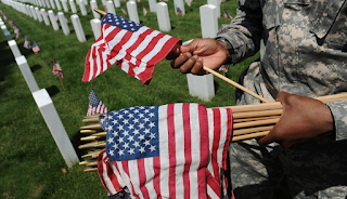 What can't you take to Arlington National Cemetery on July 4? An American flag