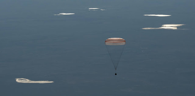 The Soyuz MS-07 spacecraft is seen as it lands with Expedition 55 crew members Anton Shkaplerov of Roscosmos, Scott Tingle of NASA, and Norishige Kanai of the Japan Aerospace Exploration Agency (JAXA) near the town of Zhezkazgan, Kazakhstan on Sunday, June 3, 2018. Shkaplerov, Tingle, and Kanai are returning after 168 days in space where they served as members of the Expedition 54 and 55 crews onboard the International Space Station. Credit: NASA/Bill Ingalls