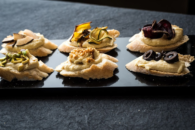 Hummus crostini with assorted toppings