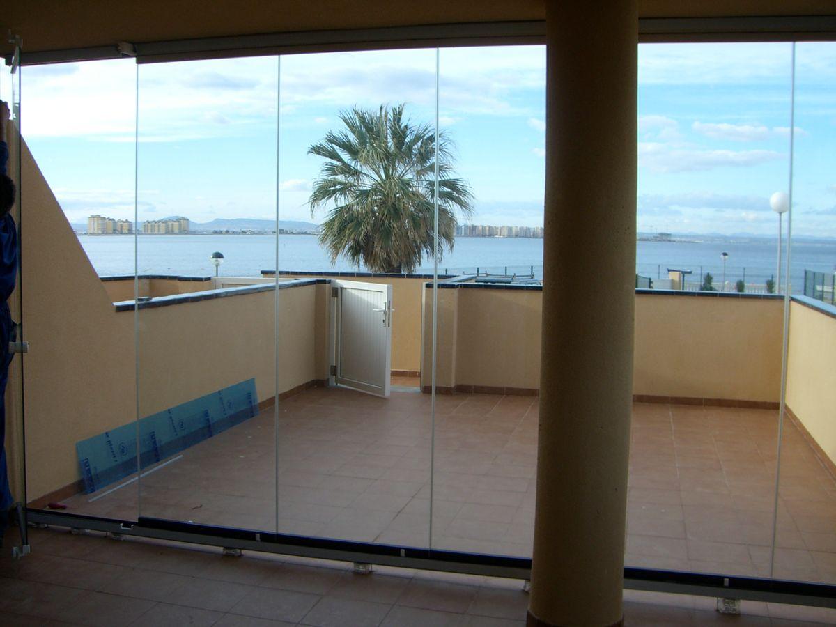 Terrazas y balcones cerramientos de cristal sevilla for Cerramientos de cristal para terrazas