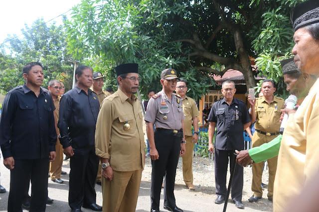 Kunker Kecamatan Nuangan - Motongkad, Sehan Landjar Serahkan KIP dan KIS