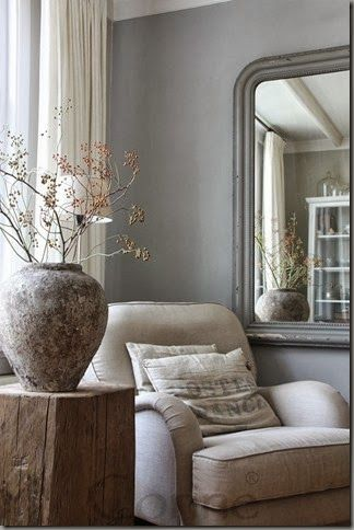 Beautiful Belgian style with linen chair and grainsack pillow on Hello Lovely