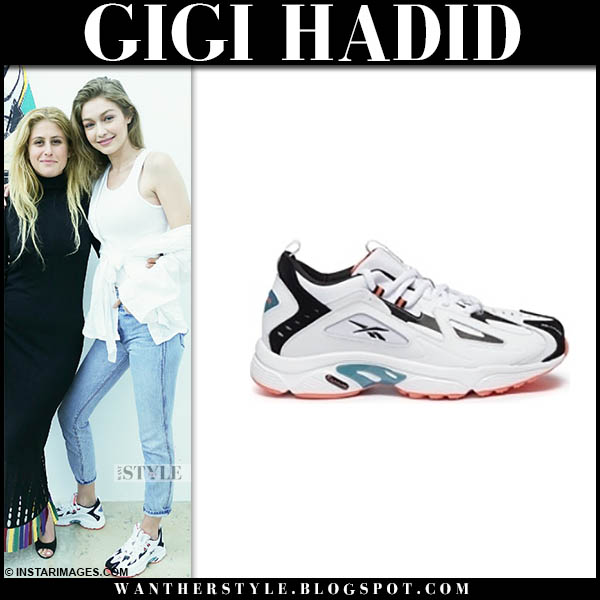 Gigi Hadid in white reebok dmx sneakers and jeans model off duty style november 24