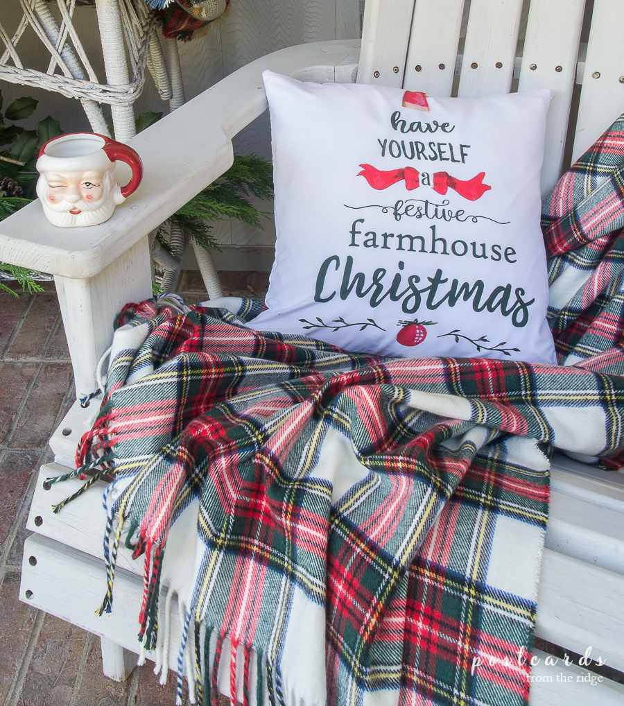 plaid throw blanket with farmhouse Christmas pillow cover and Santa mug