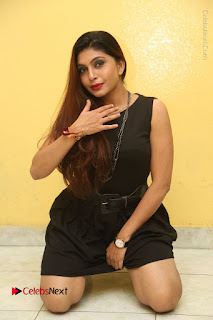 Tollywood Upcoming Actress Pooja Roshan Stills in Black Short Dress at Plus 1 Movie Trailer Launch  0253.JPG