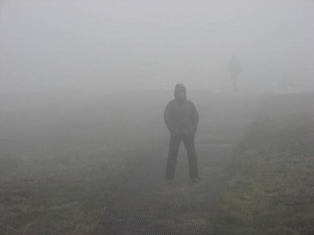woman half hidden in mist