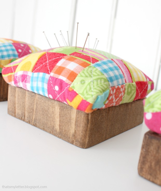 quilted pincushion with wood base