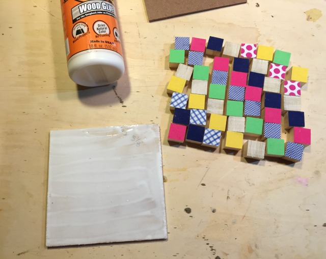wood quilt squares onto plywood backing