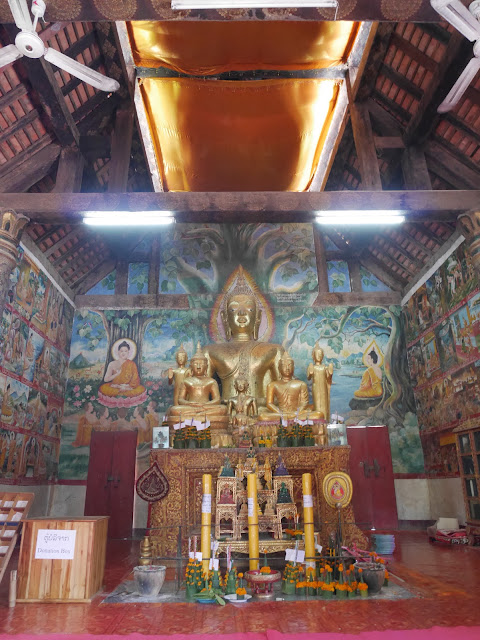 Buddhist shrine and temple murals inside Wat Aham, Luang Prabang