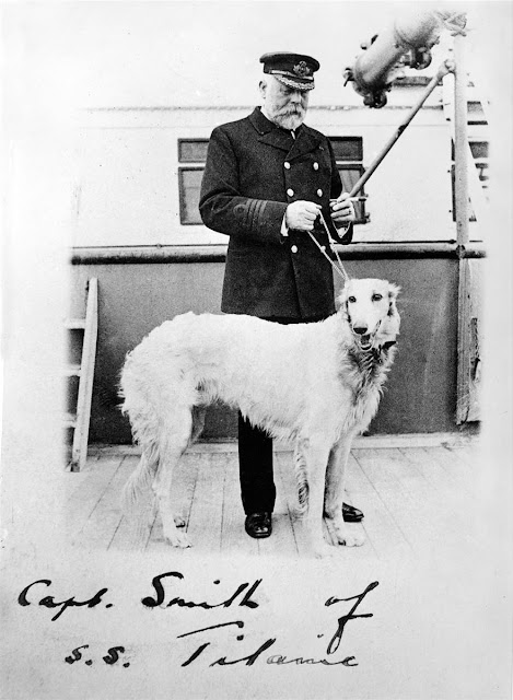 "Capt. Smith of the S.S. Titanic with his dog. ""I never saw a wreck and never have been wrecked, nor was I ever in any predicament that threatened to end in disaster of any sort. You see, I am not very good material for a story."" - Captain Smith. Cross Sea marchmatron.com"