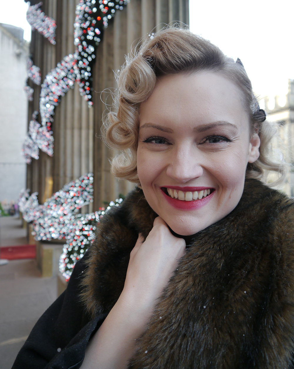British vintage style blogger, faux fur trimmed Henry Holland coat, gold glitter clutch for christmas party, easy vintage pincurl style with tongs, fashion blogger christmas outfit,
