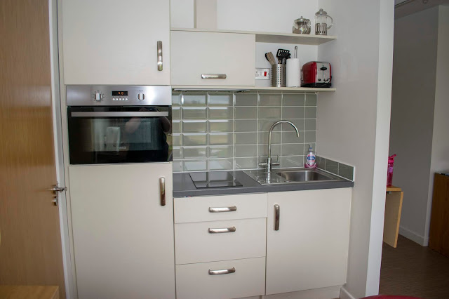 Studio kitchen, all white and grey