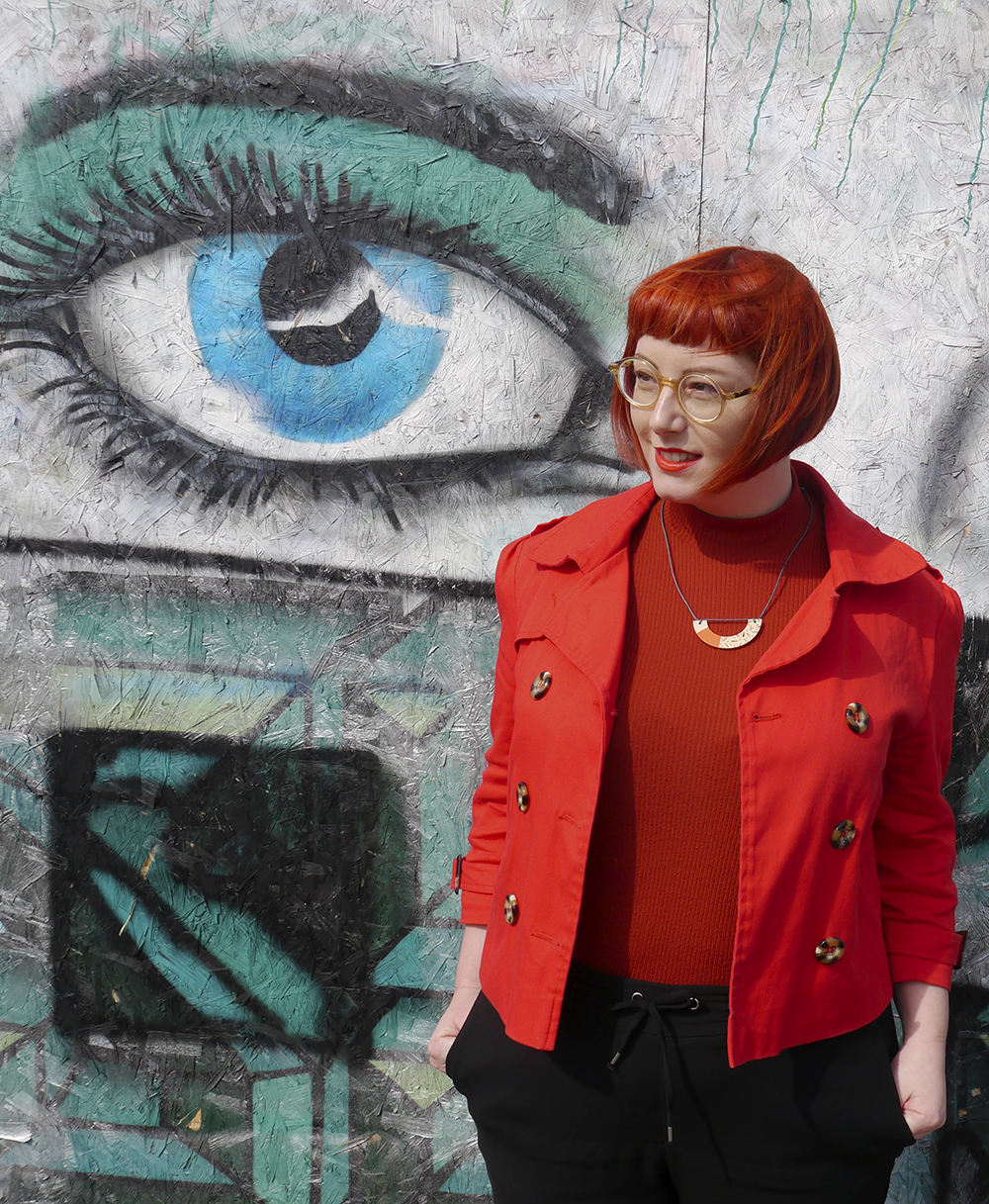 Colourful street style from Scottish blogger Helen from Wardrobe Conversations against a colourful graffiti wall with eye design painted in Dundee
