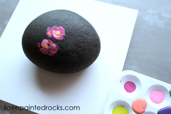 flower painting on rocks or stones