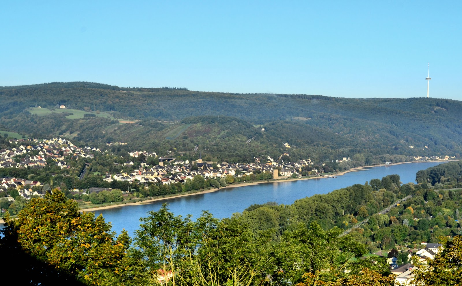 This view of the venerable Rhine was taken from Marksburg Castle. Beyond the flowing waters, Brey and Rhens lie on the opposite bank.