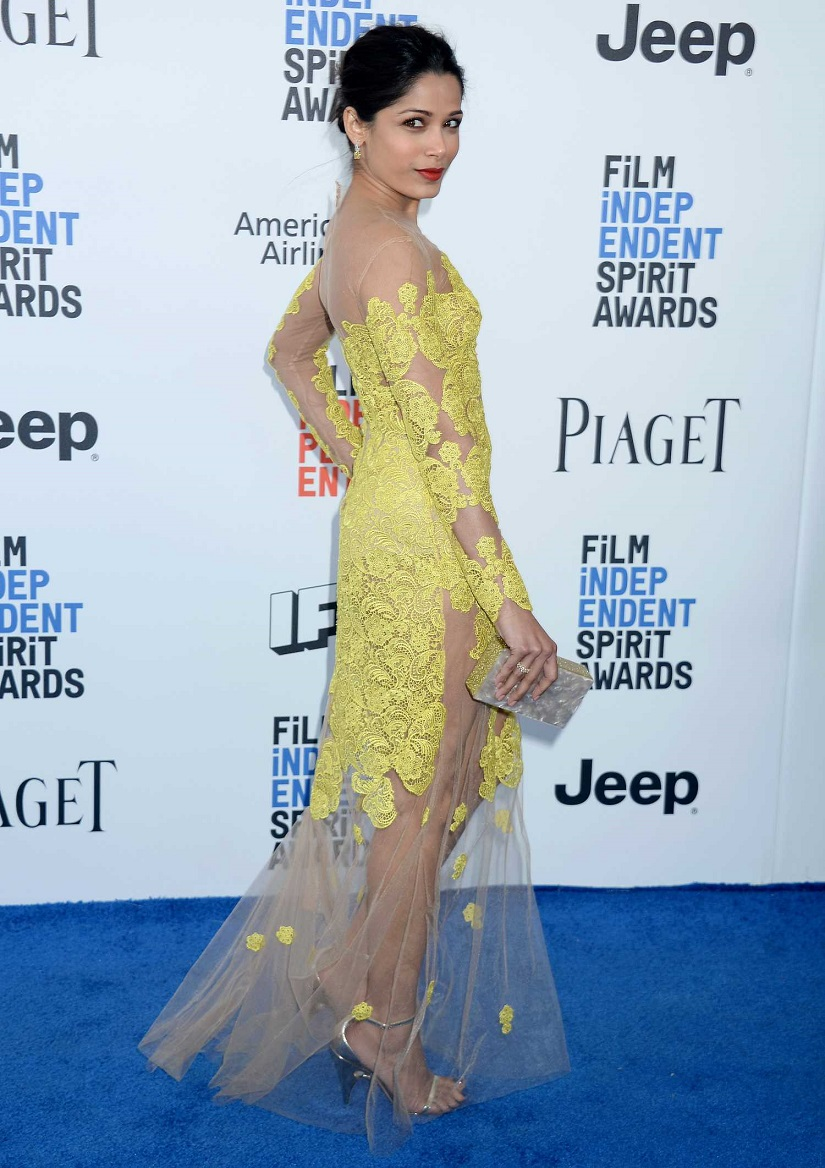 Freida Pinto stuns in a yellow gown and 9ct diamond earrings at Independent Spirit Awards