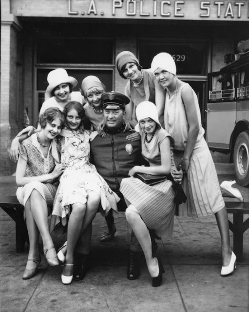 LAPD Models and policeman pose in front of the L.A. Police Department in a vintage ad for the Pickwick Motor Stages Bus Company, Los Angeles - 1928. Hey Ladies. marchmatron.com