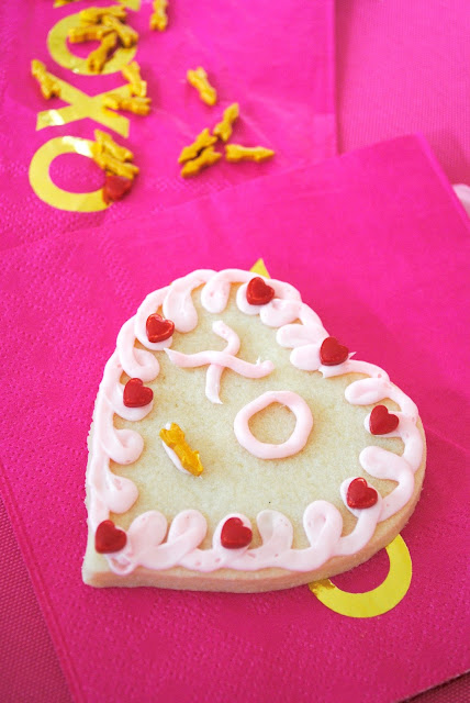 Your friends will have fun decorating cookies at your Galentine's cookie decorating party. Get inspiration at www.fizzyparty.com