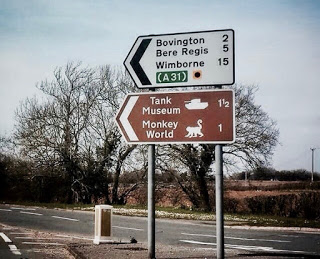 Direction sign to Tank Museum and Monkey World, Winborne.  A Planet of the Apes warning. Contingency plans and Other stories of Military Intelligence marchmatron.com